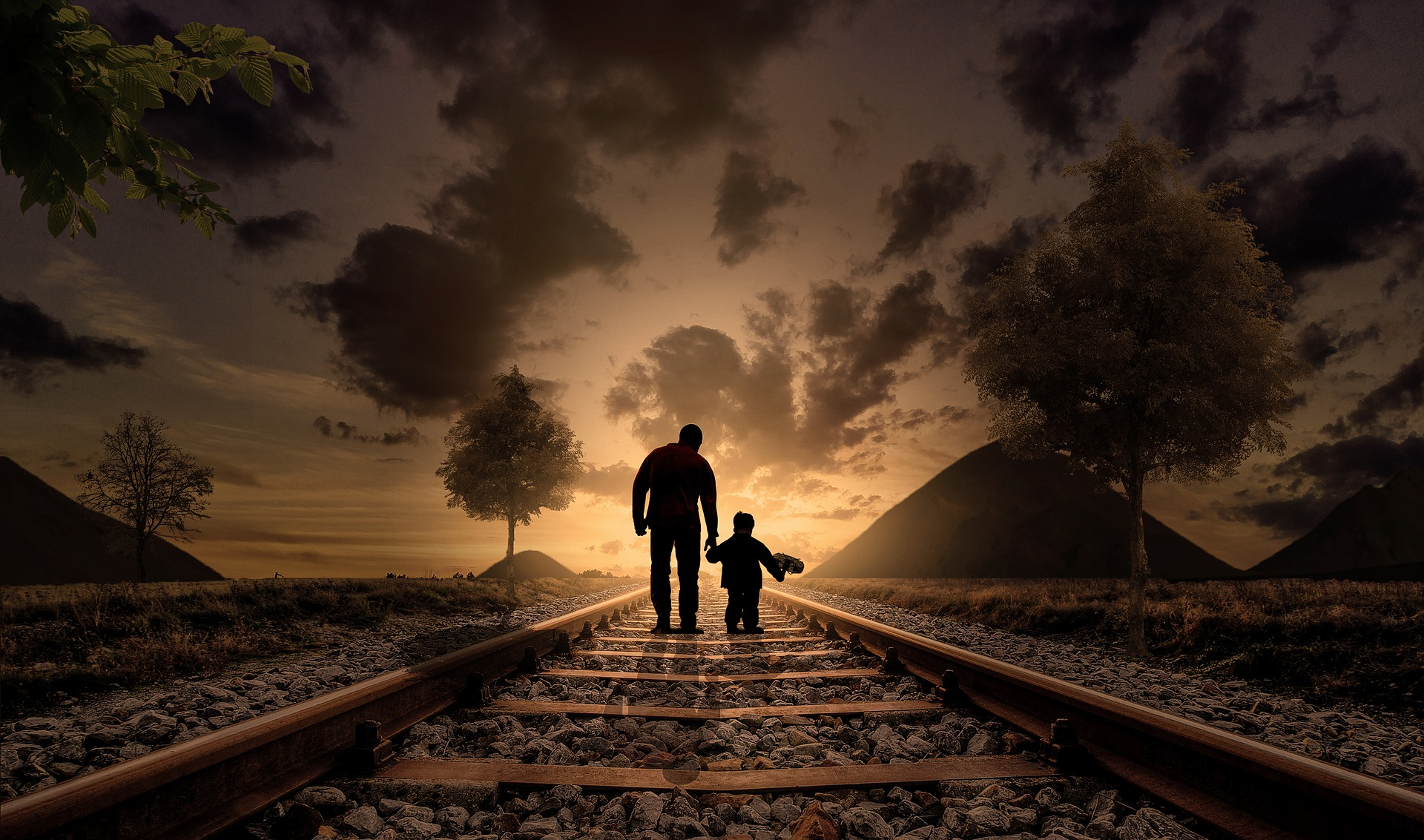 Father and son walking on the railway